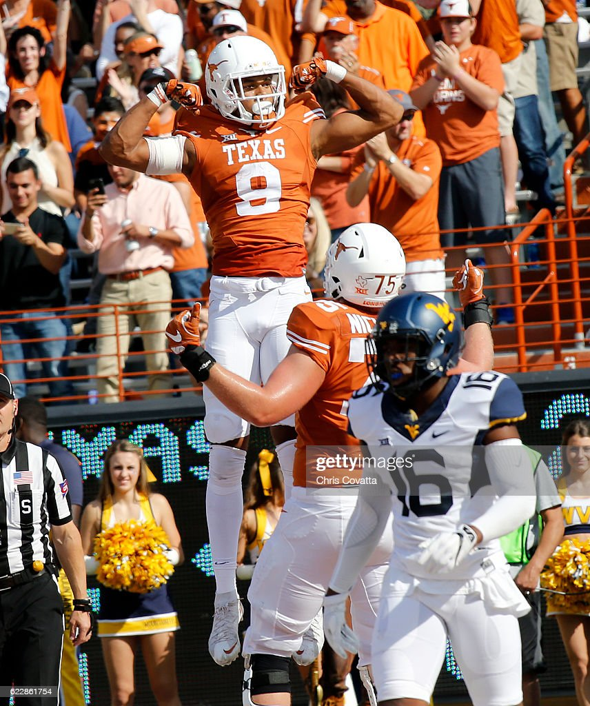 Collin Johnson #9 of the Texas Longhorns celebrates after scoring a touchdown against the West Virginia Mountaineers at Darrell K Royal -Texas Memorial Stadium on November 12, 2016 in Austin. Texas.