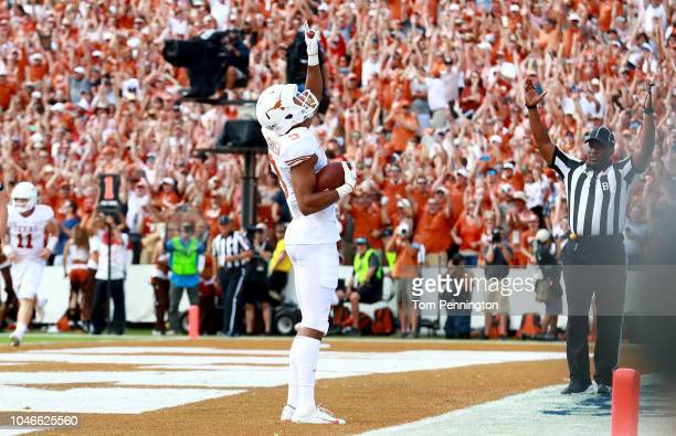 Collin Johnson of the Texas Longhorns celebrates in the end zone after scoring a touchdown against the Oklahoma Sooners in the first half of the 2018...