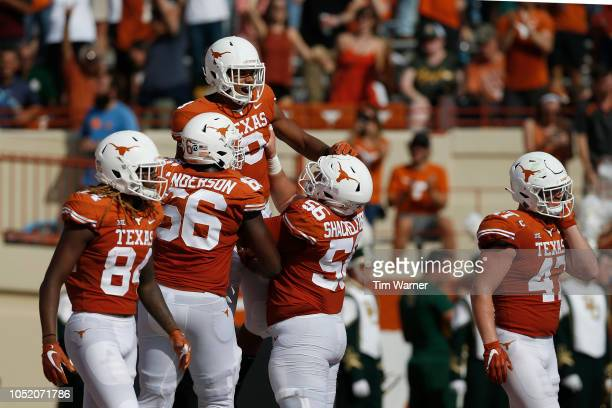 Collin Johnson of the Texas Longhorns is congratulated by teammates after a first half touchdown against the Baylor Bears at Darrell K RoyalTexas...