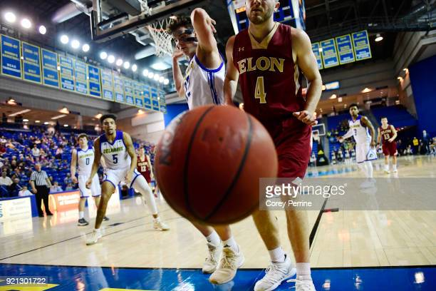 Collin Luther of the Elon Phoenix is the last to touch the ball as it lands out of bounds against Jacob Cushing of the Delaware Fightin Blue Hens...