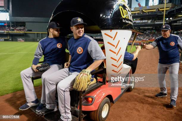 Collin McHugh and Brad Peacock of the Houston Astros take a ride in the bullpen cart prior to the MLB game against the Arizona Diamondbacks at Chase...