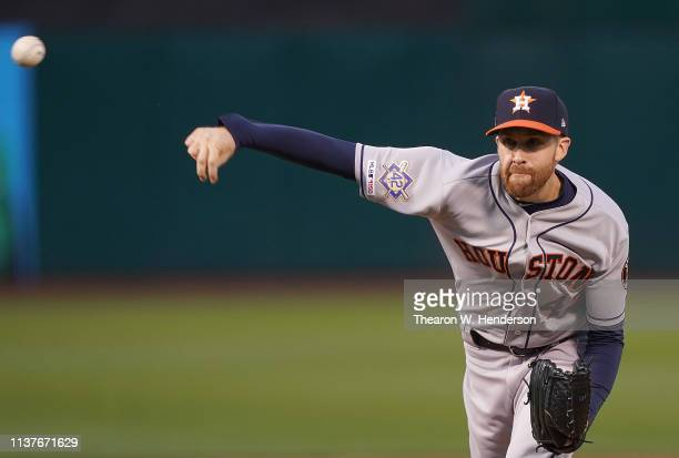 Collin McHugh of the Houston Astros pitches against the Oakland Athletics in the bottom of the first inning of a Major League Baseball game at...