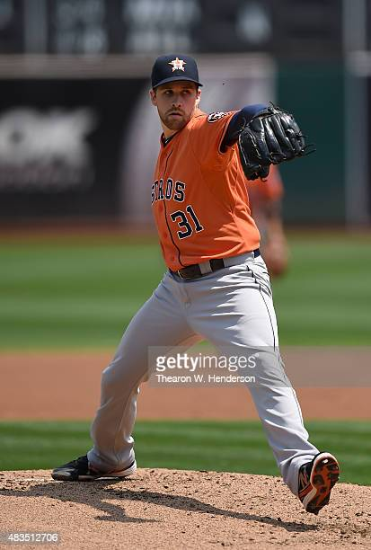 Collin McHugh of the Houston Astros pitches against the Oakland Athletics in the bottom of the first inning at Oco Coliseum on August 8 2015 in...