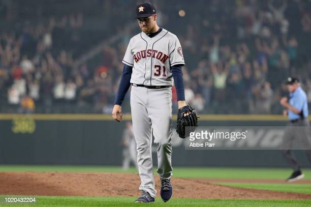 Collin McHugh of the Houston Astros reacts after giving up a three run home run to Robinson Cano of the Seattle Mariners in the eight inning to give...