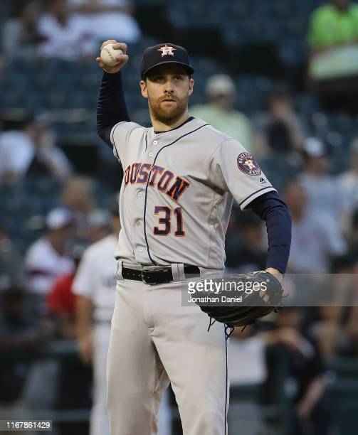 Collin McHugh of the Houston Astros throws out a Chicago White Sox runner in the 9th inning at Guaranteed Rate Field on August 13 2019 in Chicago...