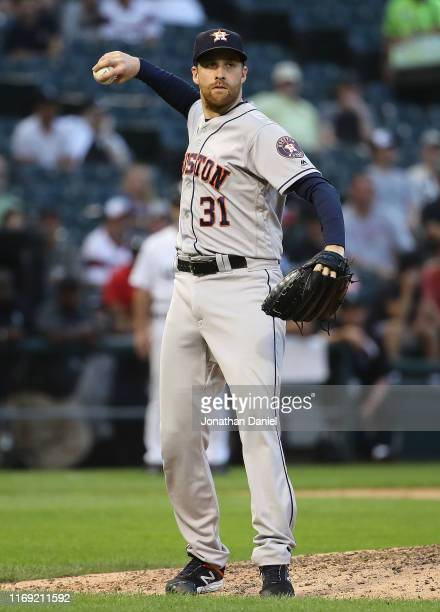 Collin McHugh of the Houston Astros throws out a Chicago White Sox runner at Guaranteed Rate Field on August 13 2019 in Chicago Illinois The Astros...
