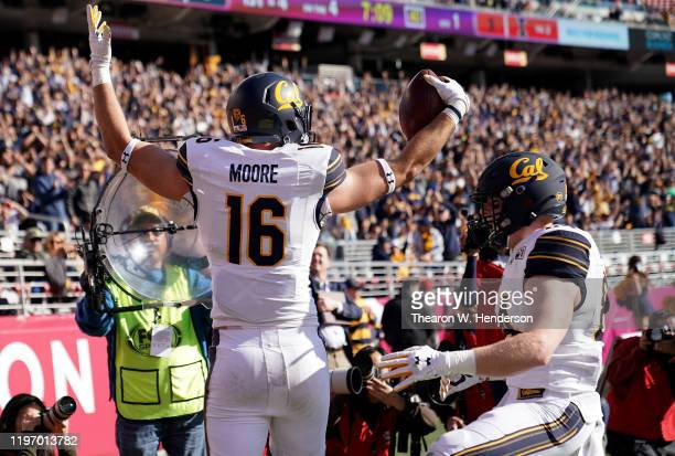 Collin Moore and Gavin Reinwald of the California Golden Bears celebrates after Moore caught a touchdown pass against the Illinois Fighting Illini...