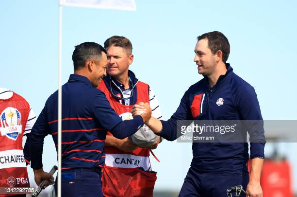 Collin Morikawa of team United States and Patrick Cantlay of team United States shake hands on the 15th green during Friday Morning Foursome Matches...