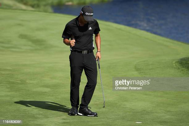 Collin Morikawa of the United States celebrates after making his final putt to win the Barracuda Championship during the final round at Montreux...