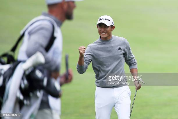 Collin Morikawa of the United States celebrates chipping in for birdie on the 14th hole during the final round of the 2020 PGA Championship at TPC...