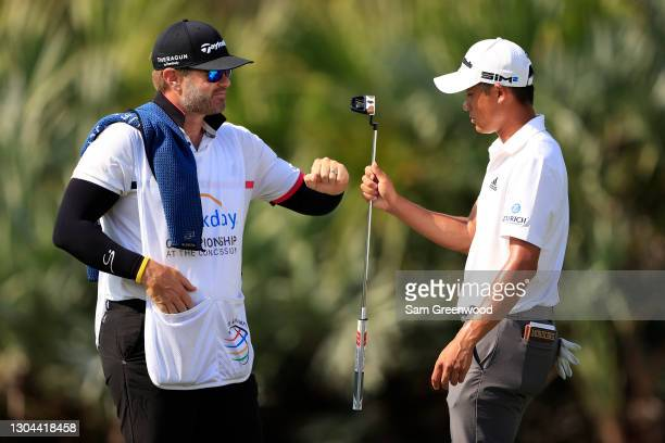Collin Morikawa of the United States celebrates making a putt for birdie on the sixth hole with caddie J.J. Jakovac during the third round of the...