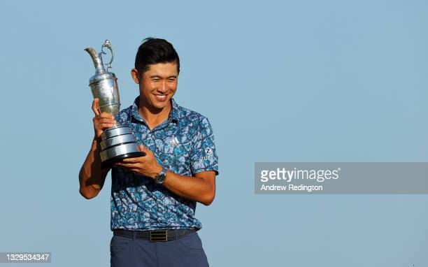Collin Morikawa of the United States celebrates with the Claret Jug after winning The 149th Open at Royal St George's Golf Club on July 18, 2021 in...