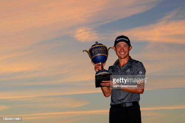 Collin Morikawa of the United States celebrates with the Gene Sarazen Cup during the trophy ceremony after winning the final round of World Golf...