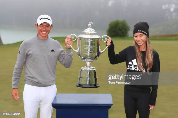 Collin Morikawa of the United States celebrates with the Wanamaker Trophy and girlfriend Katherine Zhu after winning the 2020 PGA Championship at TPC...