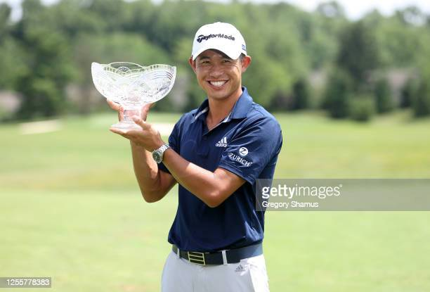 Collin Morikawa of the United States celebrates with the winner's trophy after the final round of the Workday Charity Open on July 12, 2020 at...