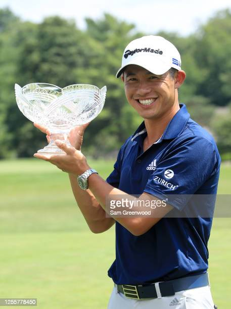 Collin Morikawa of the United States celebrates with the winner's trophy after the final round of the Workday Charity Open on July 12 2020 at...
