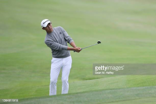 Collin Morikawa of the United States chips in for birdie on the 14th hole during the final round of the 2020 PGA Championship at TPC Harding Park on...