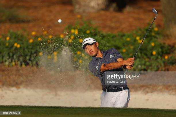 Collin Morikawa of the United States plays a shot from a bunker on the 14th hole during the first round of THE PLAYERS Championship on THE PLAYERS...