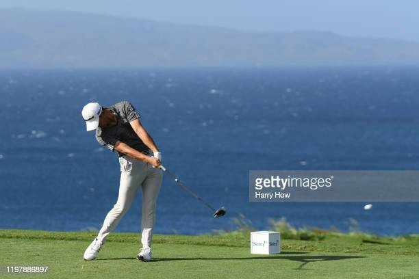 Collin Morikawa of the United States plays his shot from the 13th tee during the final round of the Sentry Tournament Of Champions at the Kapalua...