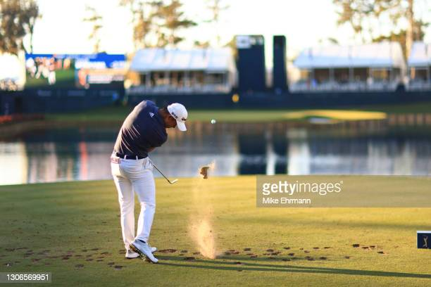 Collin Morikawa of the United States plays his shot from the 17th tee during the first round of THE PLAYERS Championship on THE PLAYERS Stadium...
