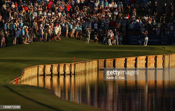 Collin Morikawa of the United States plays his shot from the 18th tee during the first round of THE PLAYERS Championship on THE PLAYERS Stadium...