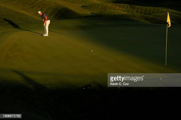 Collin Morikawa of the United States putts on the 18th green during the first round of THE PLAYERS Championship on THE PLAYERS Stadium Course at TPC...