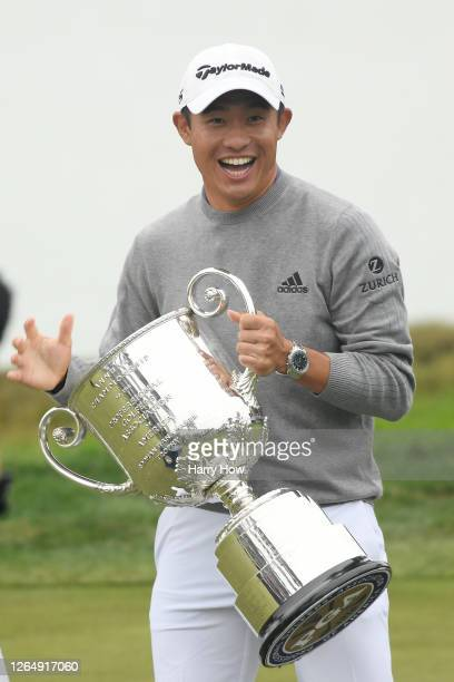 Collin Morikawa of the United States reacts after dropping the lid to the Wanamaker Trophy during the trophy presentation after the final round of...
