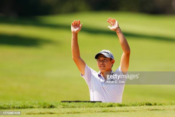 Collin Morikawa of the United States reacts after holing out from a bunker on the first hole during the third round of the TOUR Championship at East...