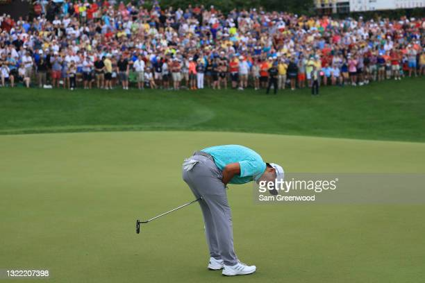Collin Morikawa of the United States reacts after missing a birdie putt on the 18th green in the first playoff hole of the final round of The...