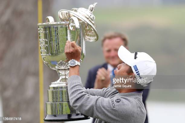 Collin Morikawa of the United States reacts as the lid to the Wanamaker Trophy falls off during the trophy presentation after the final round of the...