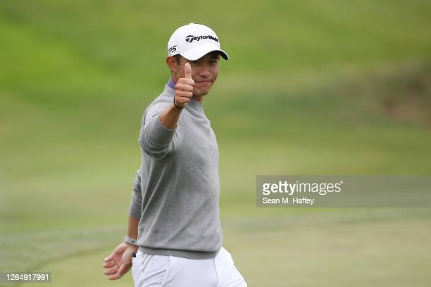 Collin Morikawa of the United States reacts in celebration after making his final putt on the 18th green during the final round of the 2020 PGA...