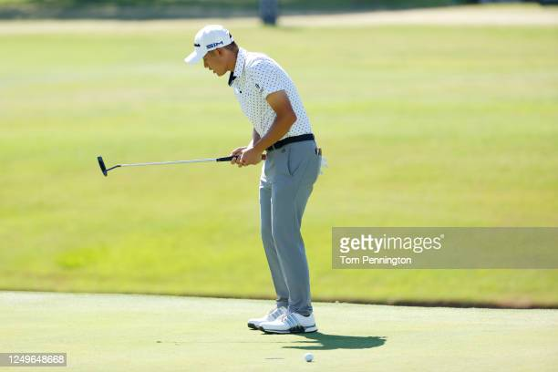 Collin Morikawa of the United States reacts to a missed putt on the 18th green during the final round of the Charles Schwab Challenge on June 14 2020...
