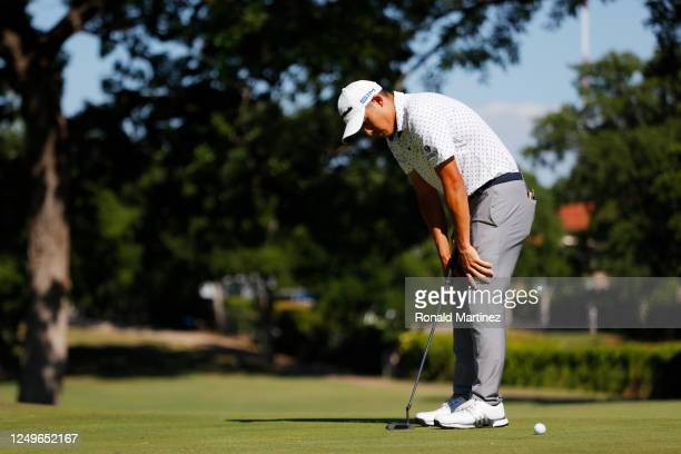 Collin Morikawa of the United States reacts to his missed putt during a playoff on the 17th green in the final round of the Charles Schwab Challenge...