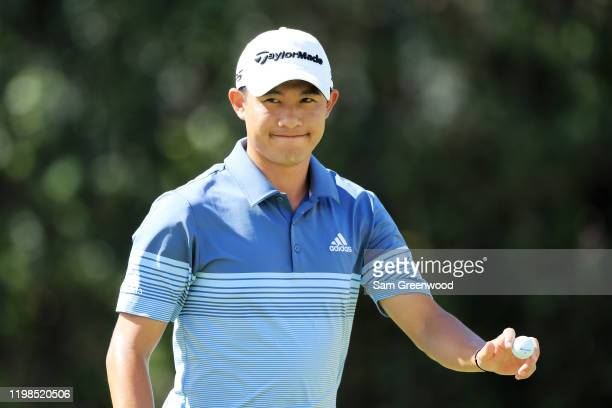 Collin Morikawa of the United States reacts to his par on the sixth green during the first round of the Sony Open in Hawaii at the Waialae Country...