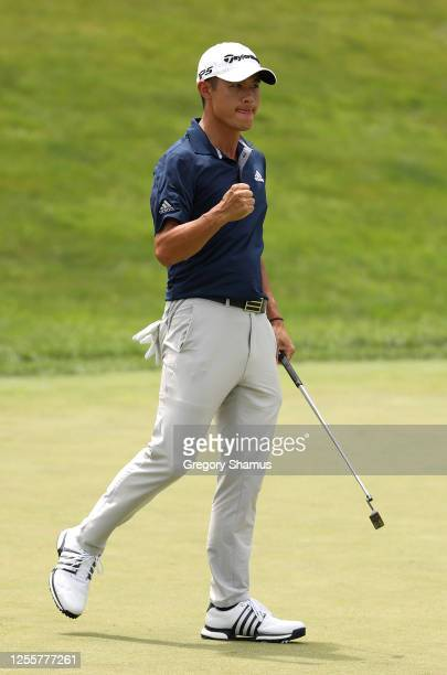 Collin Morikawa of the United States reacts to his putt on the 18th green during the first playoff hole in the final round of the Workday Charity...