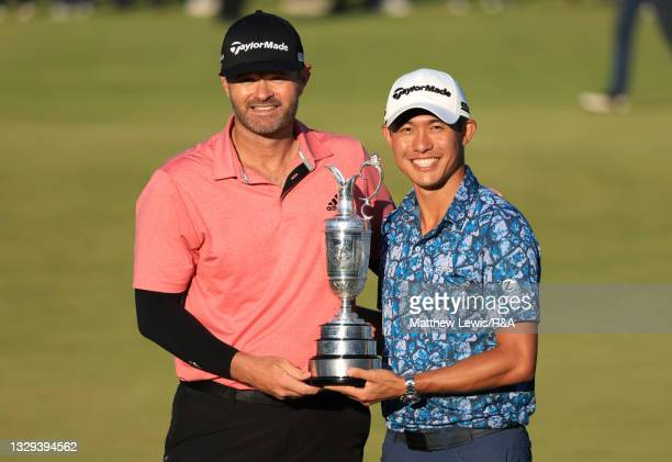 Collin Morikawa of United States celebrates with the Claret Jug and caddie Jonathan Jakovac after winning The Open to become Open Champion during Day...