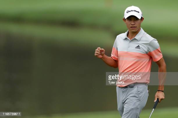 Collin Morikawa reacts after making a putt on the 15th hole during the second round of the Wyndham Championship at Sedgefield Country Club on August...