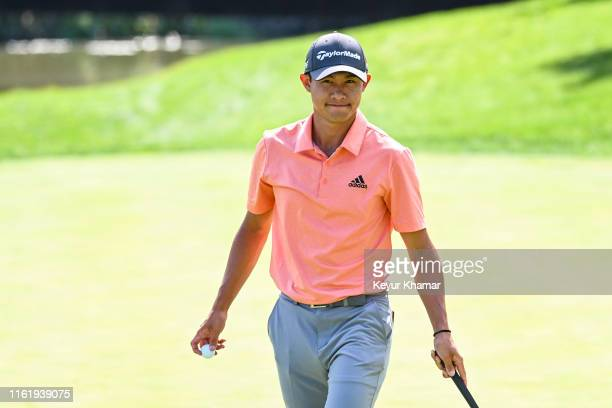 Collin Morikawa smiles after making a putt on the 17th hole green during the first round of the BMW Championship the second event of the FedExCup...