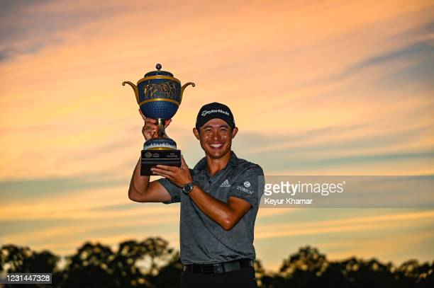 Collin Morikawa smiles with the Gene Sarazen Cup trophy after his three stroke victory during the final round of the World Golf Championships-Workday...