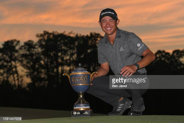 Collin Morikawa stands during the trophy ceremony on the 18th green after the final round of the World Golf Championships-Workday Championship at The...