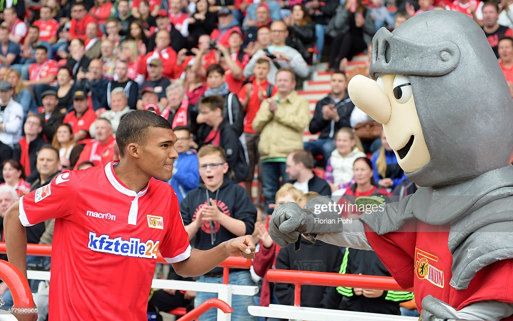 Collin Quaner and mascot Ritter Keule of 1 FC Union Berlin during the training of Union Berlin on June 21, 2015 in Berlin, Germany.