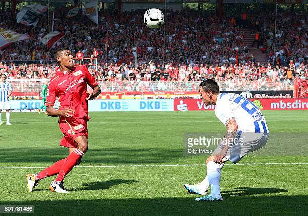 Collin Quaner of 1 FC Union Berlin and Bjarne Thoelke of Karlsruher SC during the game between dem 1 FC Union Berlin and dem Karlsruher SC on...
