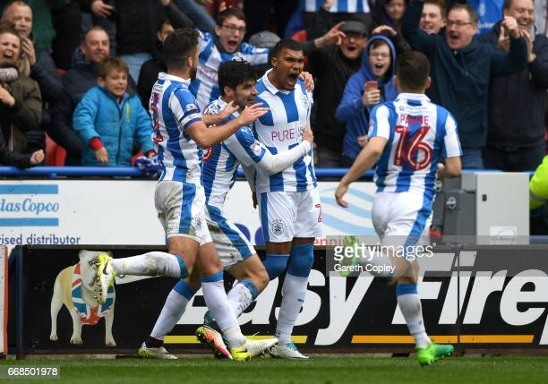 Collin Quaner of Huddersfield celebrates with teammates after scoring the winning goal during the Sky Bet Championship match between Huddersfield...