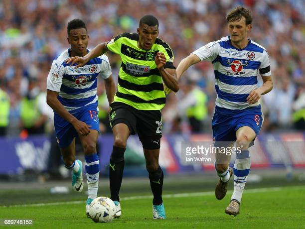 Collin Quaner of Huddersfield Town gets away from John Swift of Reading and Sandro Wieser of Reading during the Sky Bet Championship play off final...