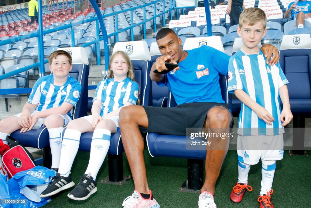 Collin Quaner of Huddersfield Town relaxes with the mascots before the Huddersfield Town v Olympique Lyonnais - Pre-Season Friendly at John Smith's Stadium on July 25, 2018 in Huddersfield, England.