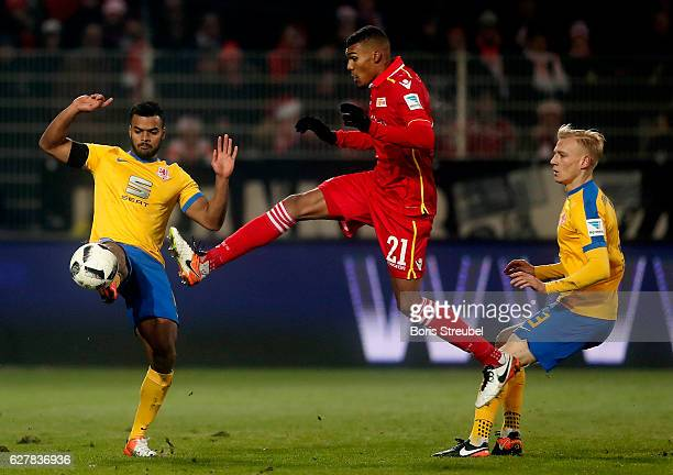 Collin Quaner of Union Berlin is challenged by Phil OfosuAyeh of Eintracht Brauschweig during the Second Bundesliga match between 1 FC Union Berlin...