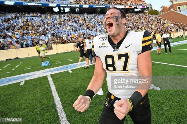 Collin Reed of the Appalachian State Mountaineers reacts after a win against the North Carolina Tar Heels at Kenan Stadium on September 21 2019 in...