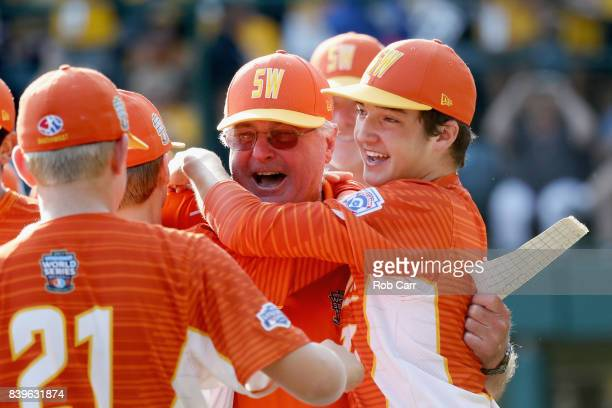 Collin Ross of the Southwest Team from Texas hugs manager Bud Maddux after beating the Southeast Team from North Carolina 65 to win the US...