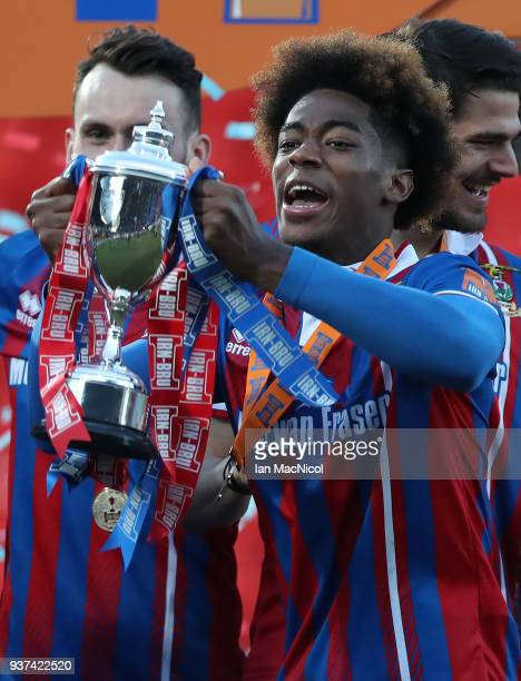 Collin Seedorf of Inverness Caledonian Thistle lifts the trophy during the IRNBRU Scottish Challenge Cup Final between Dumbarton FC v Inverness...
