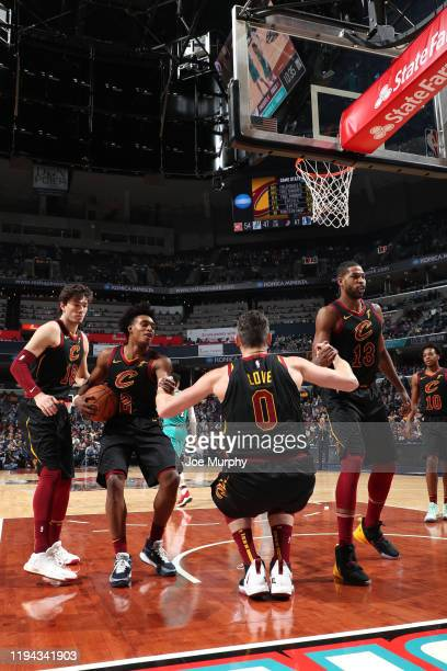 Collin Sexton and Tristan Thompson helps up Kevin Love of the Cleveland Cavaliers against the Memphis Grizzlies on January 17 2020 at FedExForum in...